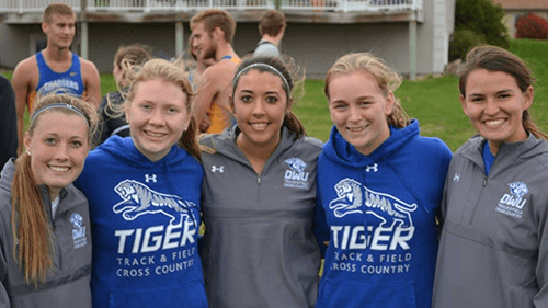McKenna Rogers, second from right, with her cross country and track teammates.